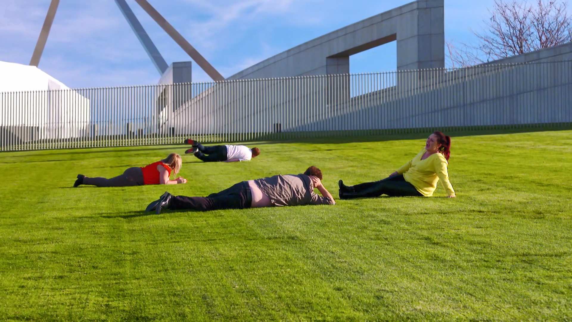 The Frens attempt to roll down the hill at Parliament House