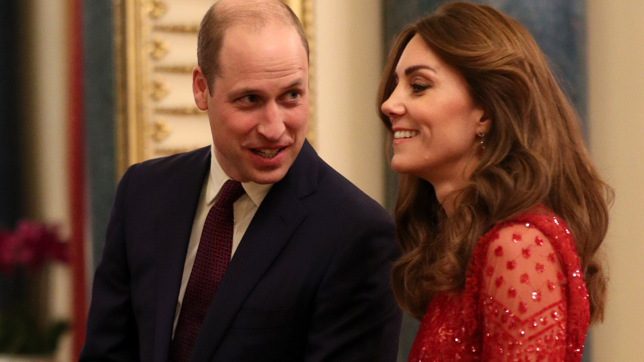 Prince William and Kate look happy at royal engagement