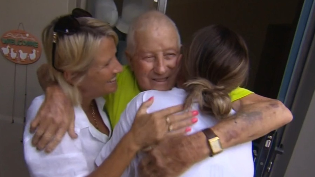 Family's emotional reunion caught on camera as Queensland border crashes down