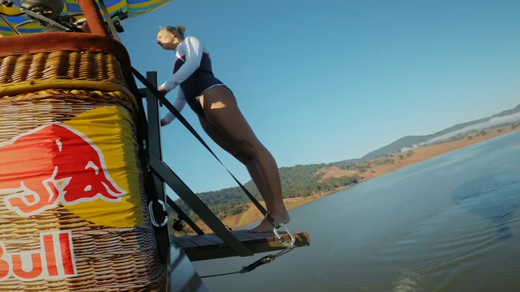 NSW woman dives into dam from moving hot air balloon