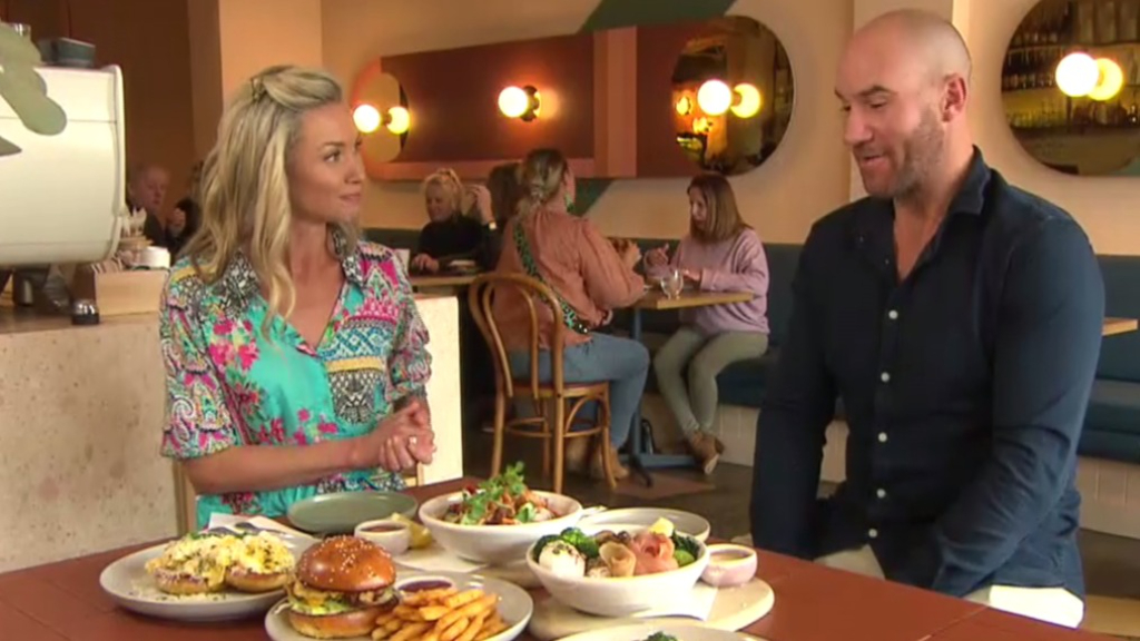 Former cricketer John Hastings shows off his delicious cafe menu