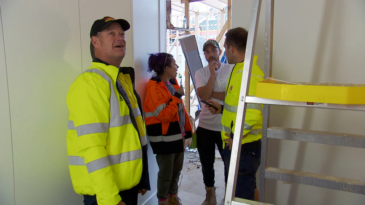 Keith and Dan give Tanya and Vito the 'kiss of death' while inspecting the teams' rooms for defects