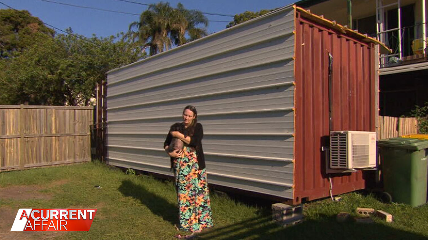 Mum forced to live in shipping container after gifting daughter home.