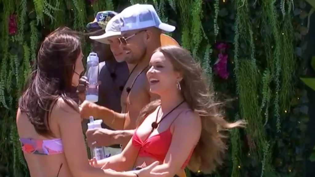 Emily 'snaps heads' as she enters the Villa
