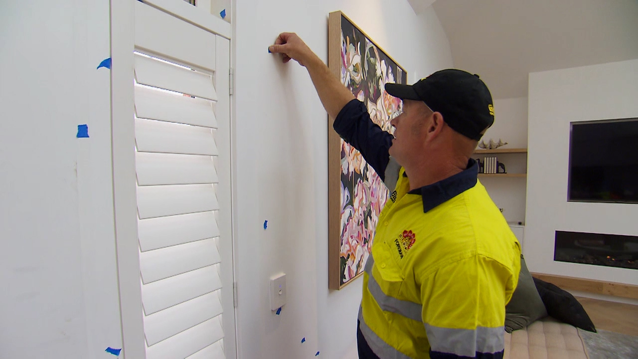 Foreman Keith plasters defect stickers across the houses